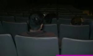 Cheerful facial in public in a cinema