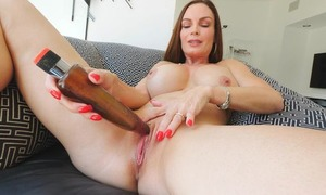 Frisky MILF with big honkers fucks personally with a giving toy